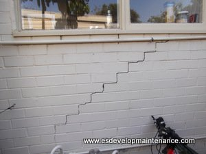 Brick wall with large cracks